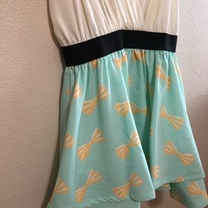 Kling Dresses - Low cut teal and cream bow pattern boutique dress